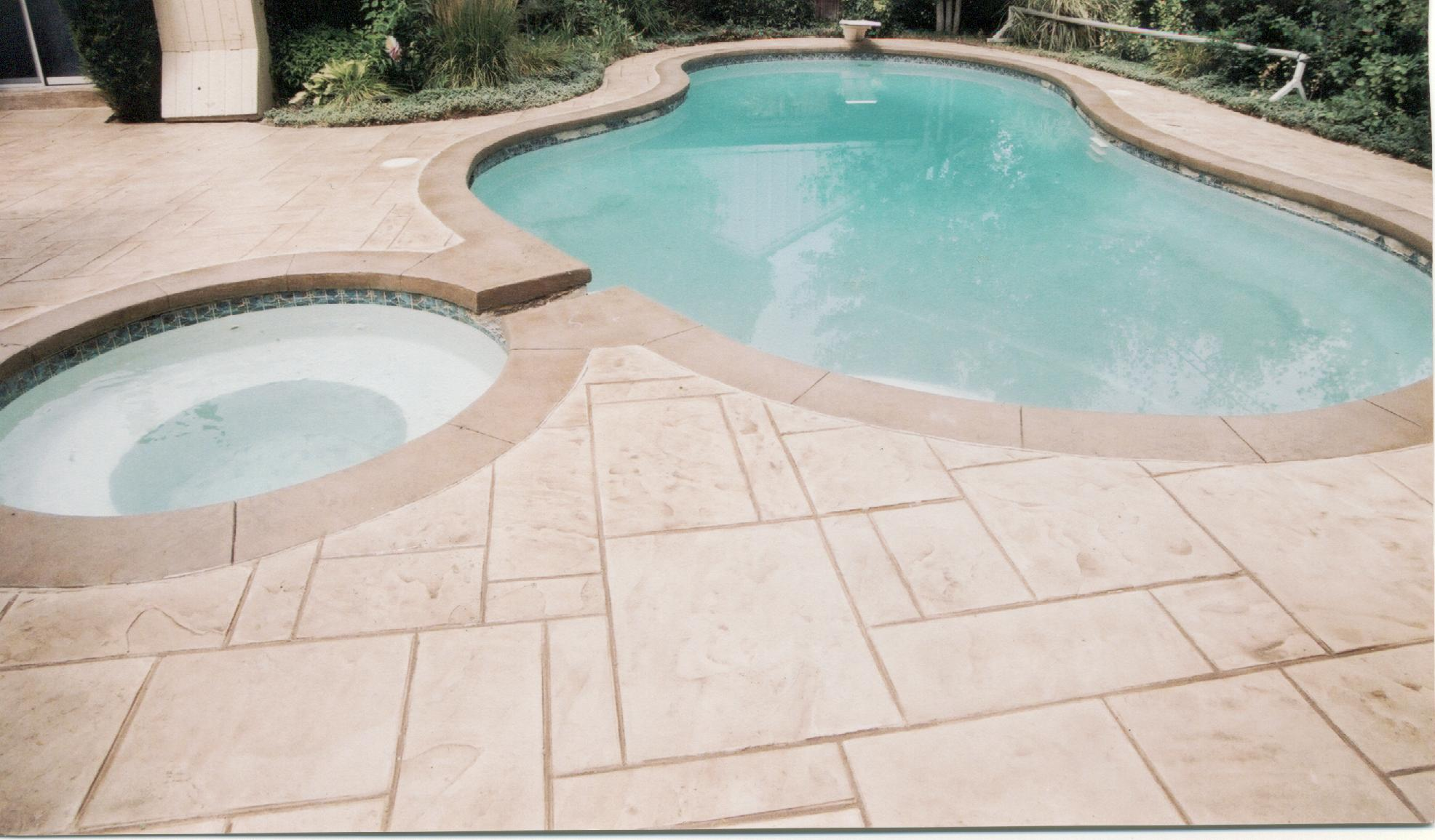 Decorative concrete pool decks front range decorative for Concrete pool